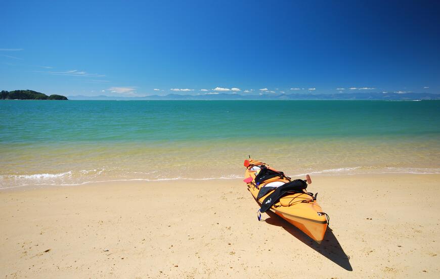 Yellow kayak at a beach. Abel Tasman National Park